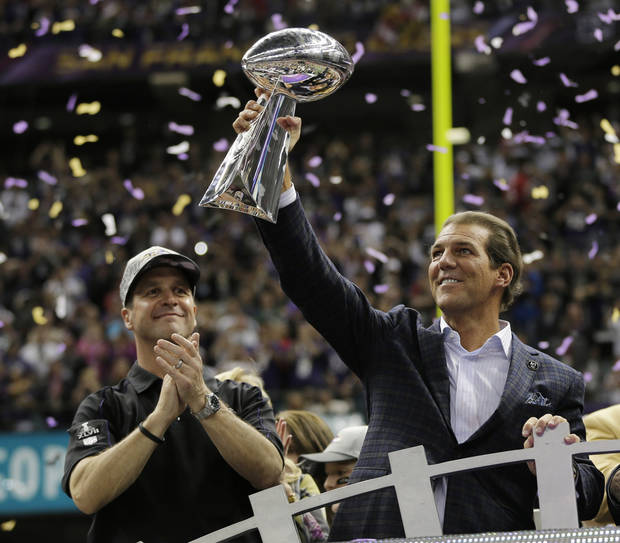 Baltimore Ravens owner Stephen J. Bisciotti holds up the Vince Lombardi Trophy as he is joined by head coach John Harbaugh after the team's 34-31 win against the San Francisco 49ers in the NFL Super Bowl XLVII football game, Sunday, Feb. 3, 2013, in New Orleans. (AP Photo/Matt Slocum)