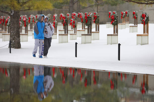 Snow art. Karen Wittman and her son Alex, 14, from Topeka, KA, walk past the snow covered wreaths on the chairs at the Oklahoma City Bombing Memorial, Friday, December 28, 2012.  Photo By David McDaniel/The Oklahoman