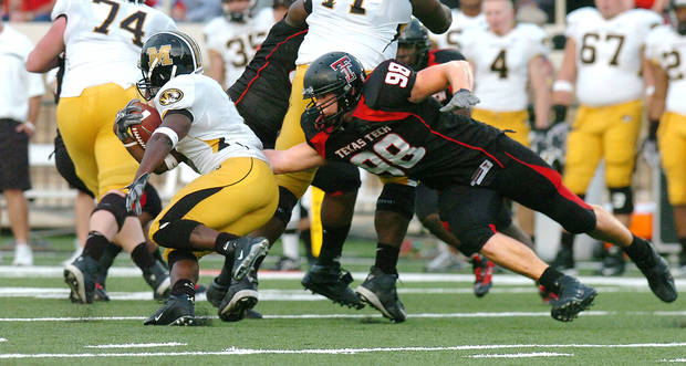 Texas Tech defensive end Jake Ratliff, right, is a key piece of the Red Raiders' defensive line, which is currently second in the conference against the run. Ratliff played high school ball at Lawton Eisenhower.AP photo