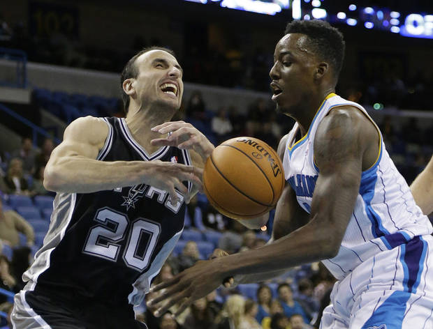San Antonio Spurs guard Manu Ginobili (20) has the ball knocked away by New Orleans Hornets forward Al-Farouq Aminu (0) in the second half of an NBA basketball game  in New Orleans, Monday, Jan. 7, 2013. The Hornets defeated the Spurs 95-88. (AP Photo/Bill Haber)