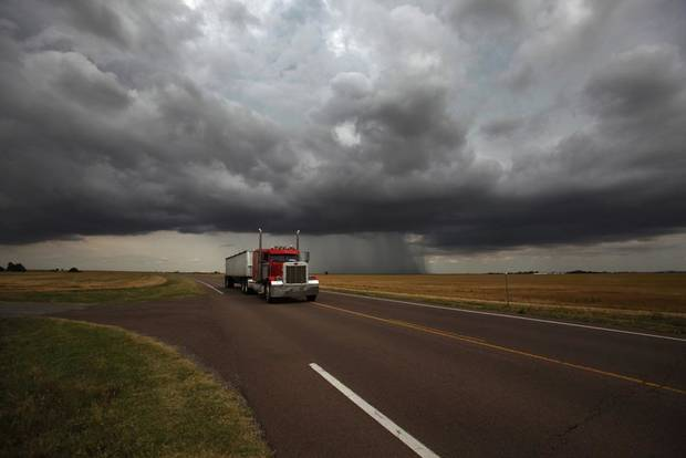 A rain cloud passes by Lone Wolf, Okla., Wednesday, June 6, 2012.  Photo by Garett Fisbeck, The Oklahoman