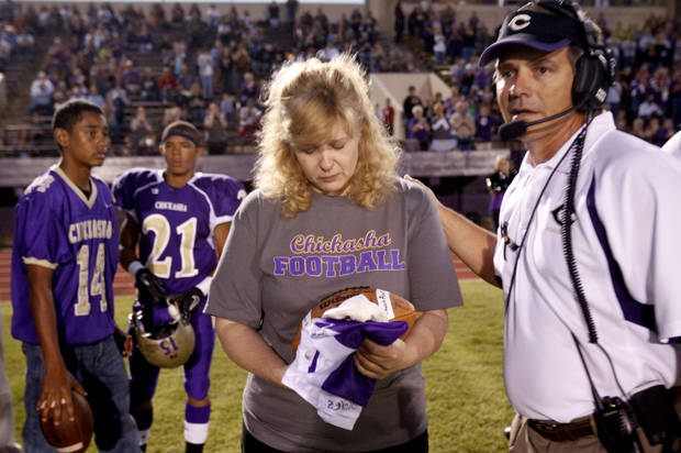 Chickasha head coach Rick VanCleave presents Kody Turner's mom, Crystal Coleman with a game ball before the football game between Chickasha and Capitol Hill at Chickasha High School, Friday, Oct. 1, 2010  It was the first home game since the death of player Kody Turner. Photo by Sarah Phipps, The Oklahoman
