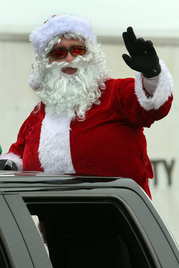 Santa Clause waves to the crowd during the 47th annual Czech Festival parade Saturday in Yukon. PHOTO BY HUGH SCOTT FOR THE OKLAHOMAN