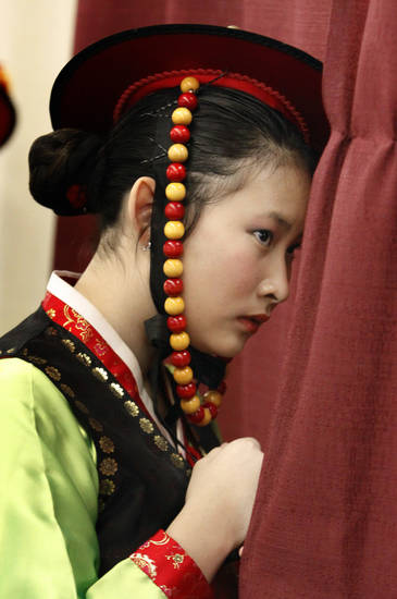 Joanna Yoon with the Korean Cultural Language School of Oklahoma looks out from behind the curtain as she waits to perform at the Annual Asian Festival on Saturday, May 14, 2011, in Oklahoma City, Okla.  Photo by Steve Sisney, The Oklahoman