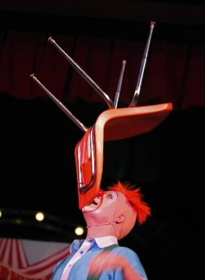 Jordan Bunce balances a chair on his chin during a Science Live show att the Science Museum of Oklahoma, Wednesday, June 27, 2012. Ringling Bros. clowns showed viewers the science behind circus performance. Photo by Garett Fisbeck, The Oklahoman