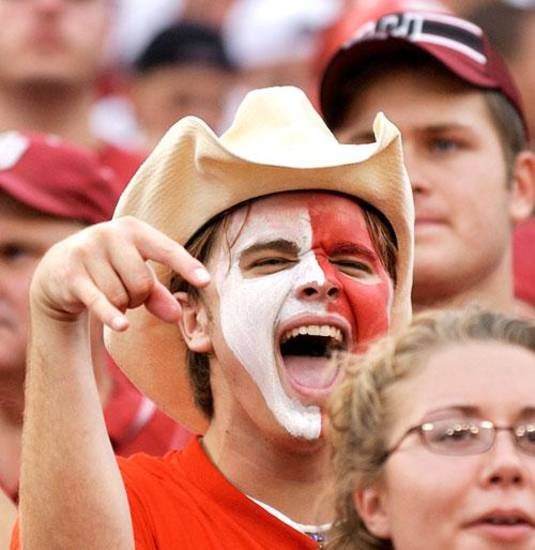 A screaming OU fan gives the inverted 'Horns sign during the OU-Texas game, October 11, 2003.  OU beat Texas, 65-13. BY JIM BECKL, THE OKLAHOMAN