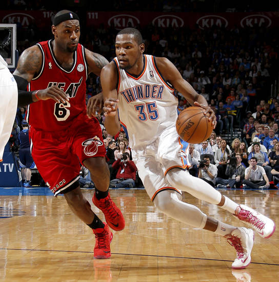 Oklahoma City's Kevin Durant (35) goes past Miami's LeBron James (6) during an NBA basketball game between the Oklahoma City Thunder and the Miami Heat at Chesapeake Energy Arena in Oklahoma City, Thursday, Feb. 15, 2013. Miami won 110-100. Photo by Bryan Terry, The Oklahoman