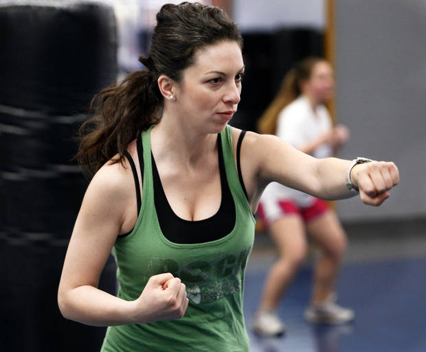 Angeliki Marko works out Tuesday during a kickboxing class on the campus of the University of Oklahoma in Norman. Photos by Steve Sisney, The Oklahoman