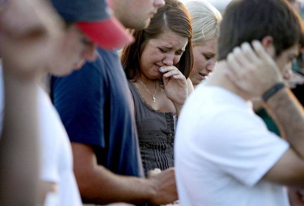 CAR ACCIDENT / DEATH: Whitney Moore, 19, cries during a vigil for her boyfriend Kyle Lewis at Bethel High School in Shawnee, Okla., Wednesday, July 28, 2010. Lewis was a Bethel High School student that graduated in May and died in a car wreck on Monday.  Photo by Bryan Terry, The Oklahoman ORG XMIT: KOD