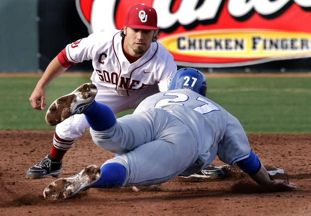 Hofstra's Douglas Rouleau is out at second with the tag of Jack Mayfield as the University of Oklahoma (OU) Sooners play Hofstra in NCAA college baseball at L. Dale Mitchell Field on Friday, Feb. 15, 2013  in Norman, Okla. Photo by Steve Sisney, The Oklahoman