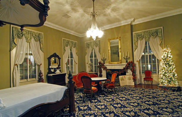 A bedroom in the historical side of the Governor's Mansion is decorated with a Christmas tree, right, and other holiday decorations, Wednesday, Dec. 5, 2012 in Jackson, Miss. The Capitol, the Old Capitol and the Governor's Mansion are among several historic buildings that are decked out with holiday decorations of a particular period style. The buildings are part of an Old Jackson Christmas by Candlelight Tour this Friday, Dec. 7, featuring live music and tours of each building. (AP Photo/Rogelio V. Solis)