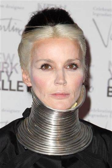 This Sept. 20, 2012 photo released by Starpix shows artist and socialite Daphne Guinness at the New York City Ballet Fall Gala honoring Valentino at Lincoln Center in New York. Valentino, who created most of the vibrant costumes and dramatically upped the glamour quotient of the evening, attracting movie stars, supermodels and socialites galore. (AP Photo/Starpix, Amanda Schwab)