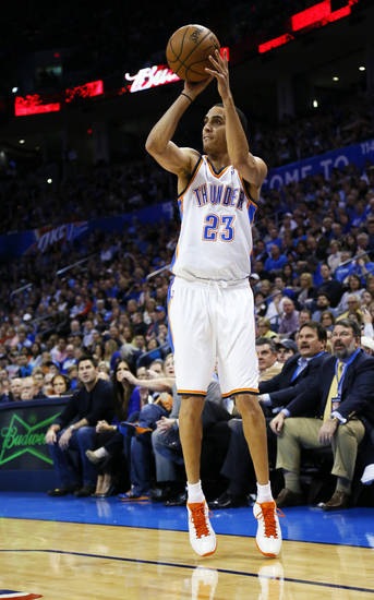 Oklahoma City&#039;s Kevin Martin (23) takes a 3-point shot during an NBA basketball game between the Oklahoma City Thunder and the Dallas Mavericks at Chesapeake Energy Arena in Oklahoma City, Monday, Feb. 4, 2013. Photo by Nate Billings, The Oklahoman