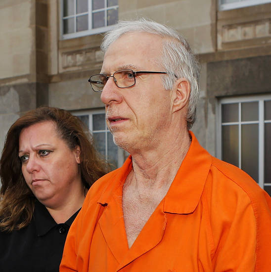 Gary Doby  is taken from the  Pottawatomie County Courthouse Wednesday afternoon, Jan. 9, 2013, after the former Oklahoma Baptist University professor  pleaded guilty  to 20 charges of sex crimes against children and was sentenced to life in prison. He must serve more than 38 years before becoming eligible for parole. Prosecutors charged Doby and Kimberly Crain, a  former teacher at McLoud Elementary School, with sex crimes for allegedly photographing some of her female students in skimpy clothing and underwear.     Photo by Jim Beckel, The Oklahoman