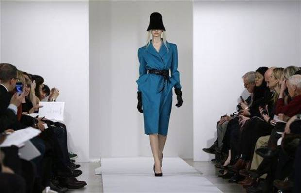 A model walks the runway during the Oscar de la Renta Fall 2013 show during Fashion Week in New York, Tuesday, Feb. 12, 2013.  (AP Photo/Kathy Willens)