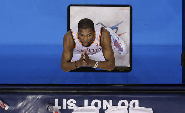 Oklahoma City Thunder's Kevin Durant (35) looks to the sky before entering the game during the NBA basketball game between the Oklahoma City Thunder and the Utah Jazz at Chesapeake Energy Arena on Wednesday, March 13, 2013, in Oklahoma City, Okla. Photo by Chris Landsberger, The Oklahoman
