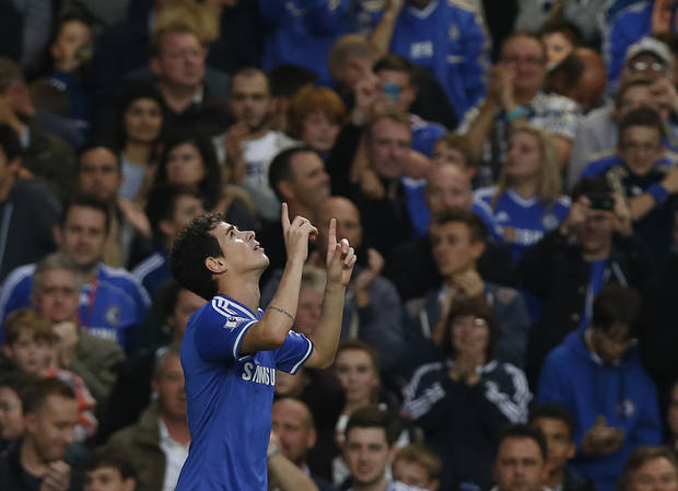 Chelsea's Oscar celebrates after scoring a goal against Fulham during the English Premier League soccer match between Chelsea and Fulham at Stamford Bridge, London, Saturday, Sept. 21, 2013. (AP Photo/Sang Tan)