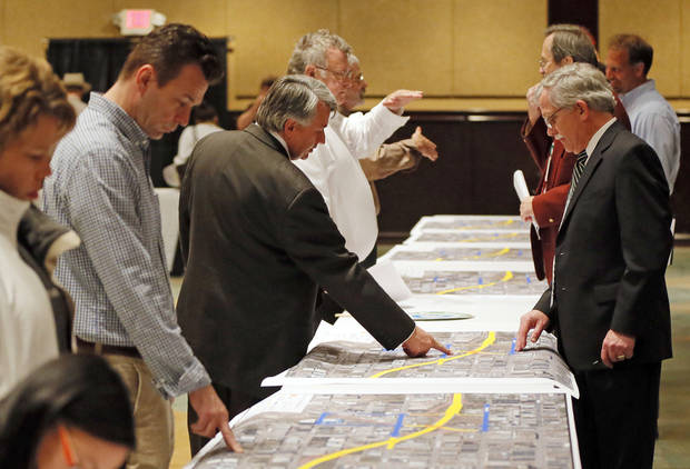 People look at proposed designs for the Oklahoma City Boulevard as it crosses Western, before a public meeting at the Coca-Cola Bricktown Events Center in Oklahoma City, Monday, Dec. 3, 2012. Photo by Nate Billings, The Oklahoman <strong>NATE BILLINGS - NATE BILLINGS</strong>