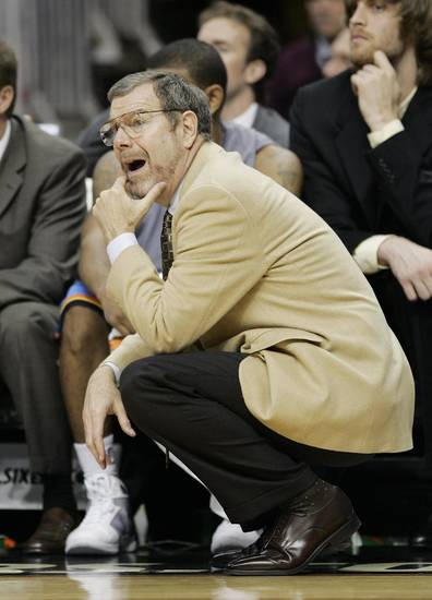 Oklahoma City Thunder head coach P.J. Carlesimo call out directions to his players in the second half of an NBA basketball game with the Philadelphia 76ers, Saturday, Nov.15, 2008, in Philadelphia. The 76ers won 110-85. (AP Photo/Tom Mihalek) ORG XMIT: PATM108