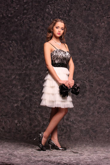 Model Ashlin wears a classic black-and-white tiered skirt with sequined cummerbund and lace bodice, $82.50. Black lace peep-toe pumps, $26.50. All sold at Deb Shops. Photo by Steve Webb, for The Oklahoman. <strong></strong>