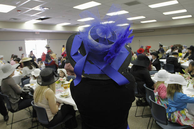 Women sporting hats of all shapes, sizes and colors attend last year�s Crowns Tea at the Norman Public Library. OKLAHOMAN ARCHIVES PHOTO