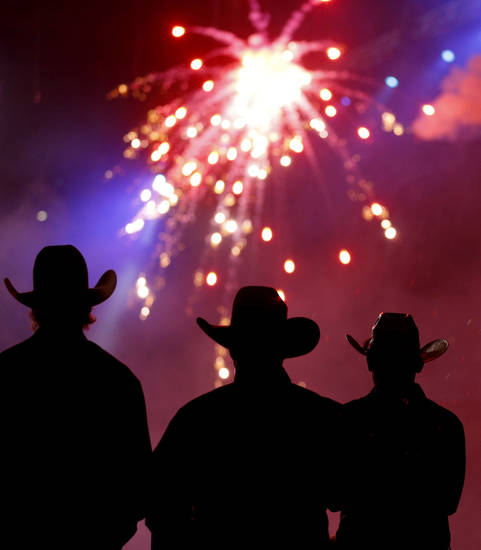 Contestants watch fireworks before the start of the National Circuit Finals Rodeo at the State Fair Arena, Saturday, April 6, 2013. Photo by Bryan Terry, The Oklahoman