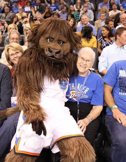 "Leola Boyd meets Rumble the Bison at the OKC Thunder's home opener on Friday, Nov. 2 in Chesapeake Energy Arena in Oklahoma City, Okla.  <br /> <Br /> ""I was looking out across the floor, and I don't remember now if it was a break when they had a timeout, but all of a sudden someone sat in my lap. I was so surprised. It was Rumble. He sat in my lap, put his arms around me. There was a man with a camera there, and he took pictures of us. I don't know how they knew I was sitting there. But anyway, I got a big hug from Rumble, and that was another thing I thought was great. Rumble gave me a shirt with his picture on it."" <Br /> <br /> <a href=""http://okne.ws/TtqzGL"">Here's the story from the evening from Berry Tramel.</a>"
