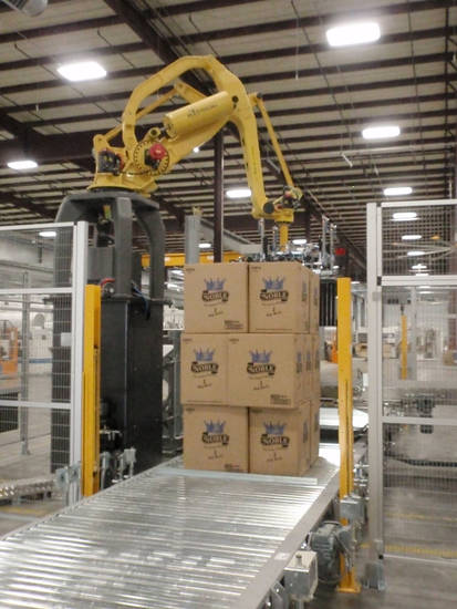 A robot handles cases of products at Orchids Paper Products in Pryor. <strong> - PROVIDED BY ORCHIDS PAPER PRODUC</strong>