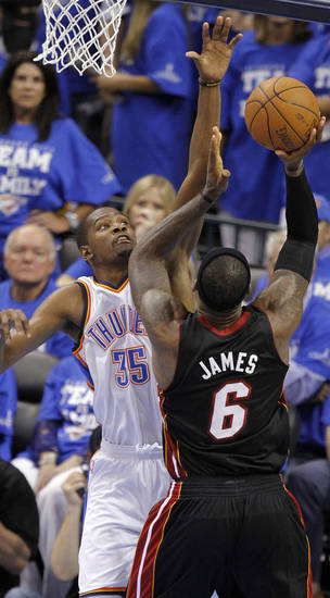 Oklahoma City's Kevin Durant (35) defends on Miami's LeBron James (6) during Game 2 of the NBA Finals between the Oklahoma City Thunder and the Miami Heat at Chesapeake Energy Arena in Oklahoma City, Thursday, June 14, 2012. Photo by Chris Landsberger, The Oklahoman