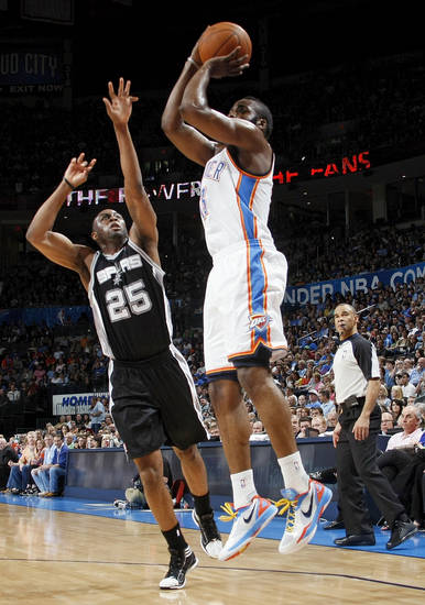 Oklahoma City's James Harden (13) takes a shot against San Antonio's James Anderson (25) during the NBA basketball game between the Oklahoma City Thunder and the San Antonio Spurs at Chesapeake Energy Arena in Oklahoma City, Friday, March 16, 2012. Photo by Nate Billings, The Oklahoman