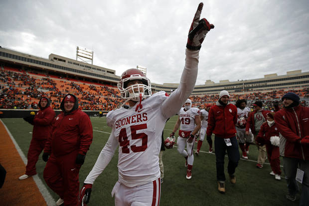 Oklahoma's Caleb Gastelum (45) celebrates following the Bedlam college football game between the Oklahoma State University Cowboys (OSU) and the University of Oklahoma Sooners (OU) at Boone Pickens Stadium in Stillwater, Okla., Saturday, Dec. 7, 2013. OU won 33-24. Photo by Sarah Phipps, The Oklahoman