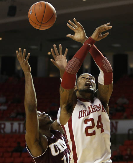 Oklahoma's Romero Osby (24) and Louisiana's Amos Olatayo (10) go up for a rebound during a men's college basketball game between the University of Oklahoma and the University of Louisiana-Monroe at the Loyd Noble Center in Norman, Okla., Sunday, Nov. 11, 2012.  Photo by Garett Fisbeck, The Oklahoman