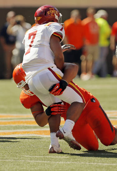 Oklahoma State's James Castleman (91) knocks down Iowa State quarterback Jared Barnett (7) after pressuring him on a throw during a college football game between Oklahoma State University (OSU) and Iowa State University (ISU) at Boone Pickens Stadium in Stillwater, Okla., Saturday, Oct. 20, 2012. OSU won, 31-10. Photo by Nate Billings, The Oklahoman