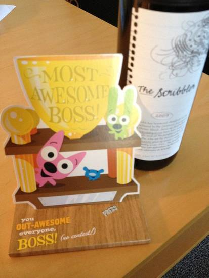 The employees of S Design Inc. presented principal Sarah Sears with a bottle of her favorite wine and a �Most Awesome Boss� card for National Boss� Day.  PHOTO PROVIDED