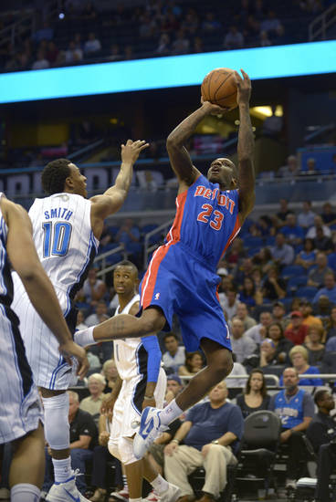 Detroit Pistons guard Walker Russell (23), right, goes up for a shot in front of Orlando Magic guard Ishmael Smith (10) during the second half of an NBA basketball game in Orlando, Fla., Monday, April 9, 2012.(AP Photo/Phelan M. Ebenhack)