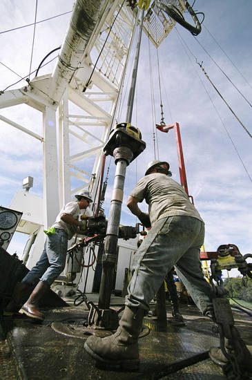Workers change drilling pipe on a Chesapeake Energy Corp. rig near Marlow in this file photo from 2004. Photo by Steve Sisney, The Oklahoman Archives
