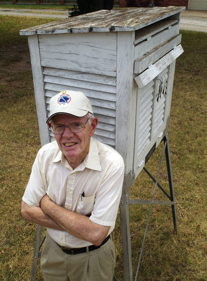Clemon Clewell, seen here in 2003, participated in the National Weather Service Cooperative Observing Network for decades in Watonga. Clewell, 88, recently moved to Edmond.PHOTO BY PAUL HELLSTERN, THE OKLAHOMAN ARCHIVES