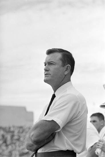 University of Texas head coach Darrell Royal watches as his Longhorns continue on their winning streak by defeating Oklahoma University in Dallas, Oct. 15, 1962.  (AP Photo)