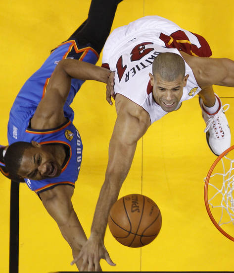 Oklahoma City Thunder point guard Russell Westbrook (0) and Miami Heat small forward Shane Battier (31) go after a rebound during the first half at Game 3 of the NBA Finals basketball series, Sunday, June 17, 2012, in Miami. (AP Photo/Mike Segar, Pool)  ORG XMIT: NBA138