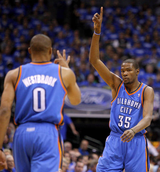 Oklahoma City's Kevin Durant (35) and Russell Westbrook (0) celebrate after a basket during Game 3 of the first round in the NBA playoffs between the Oklahoma City Thunder and the Dallas Mavericks at American Airlines Center in Dallas, Thursday, May 3, 2012. Photo by Bryan Terry, The Oklahoman