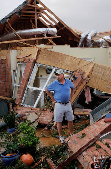 Johnny Hannah on the back porch of his home after a tornado came through the area Tuesday afternoon,  May 24, 2011,   He and his wife, Beth escaped injury when they went inside an underground shelter in their garage. Photo by Jim Beckel, The Oklahoman