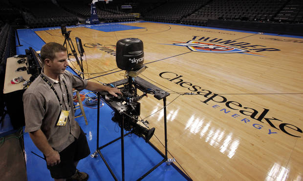 Joey Kruse helps set up the cable tethered Skycam just after 9:00 a.m. in preparation for the first game of the NBA basketball finals at the Chesapeake Arena on Tuesday, June 12, 2012 in Oklahoma City, Okla.  Photo by Steve Sisney, The Oklahoman