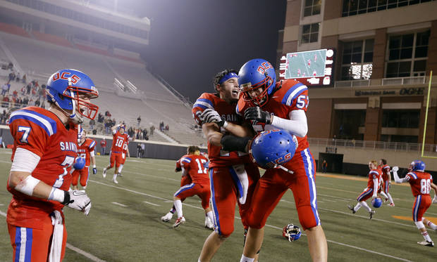 OCS celebrates following the Class 2A high school football championships between Davis and Oklahoma Christian School at Boone Pickens Stadium in Stillwater, Okla.,  Saturday,Dec. 8, 2012. Photo by Sarah Phipps, The Oklahoman