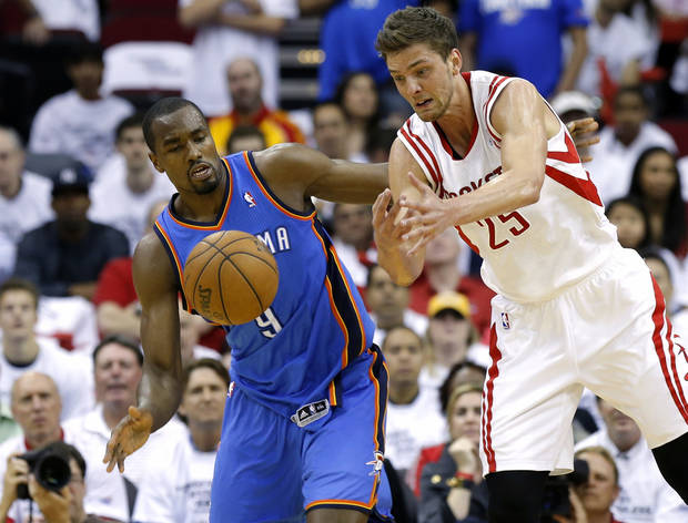 Oklahoma City's Serge Ibaka goes for the ball beside Houston's Chandler Parsons during Game 3 in the first round of the NBA playoffs between the Oklahoma City Thunder and the Houston Rockets at the Toyota Center in Houston, Texas, Sat., April 27, 2013. Photo by Bryan Terry, The Oklahoman
