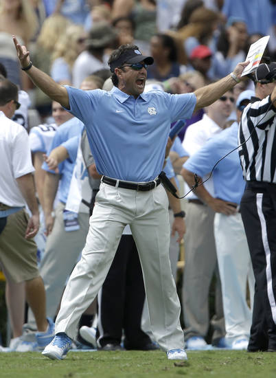 North Carolina coach Larry Fedora reacts to an official's call during the first half of an NCAA college football game against East Carolina in Chapel Hill, N.C., Saturday, Sept. 28, 2013. East Carolina won 55-31. (AP Photo/Gerry Broome)
