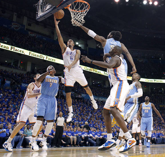 Oklahoma City's Eric Maynor (6) drives to the basket past Denver's Nene (31) and Denver's Al Harrington (7) during the first round NBA playoff game between the Oklahoma City Thunder and the Denver Nuggets on Sunday, April 17, 2011, in Oklahoma City, Okla. Photo by Chris Landsberger, The Oklahoman