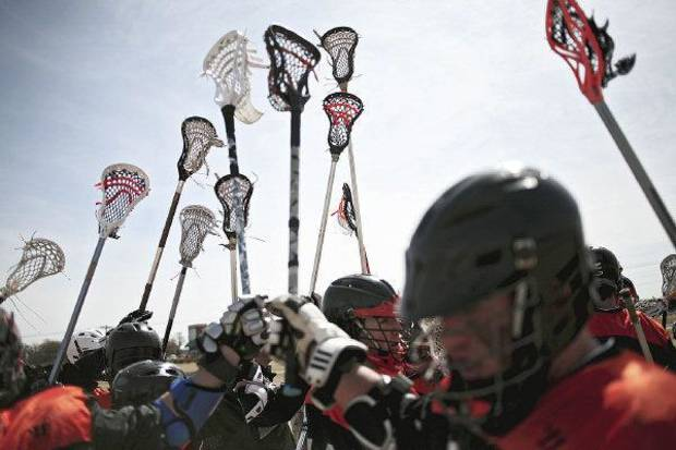 OSU's lacrosse team members hold up their sticks after getting instructions during a timeout Sunday. PHOTO BY JOHN CLANTON, THE OKLAHOMAN <strong>John Clanton</strong>
