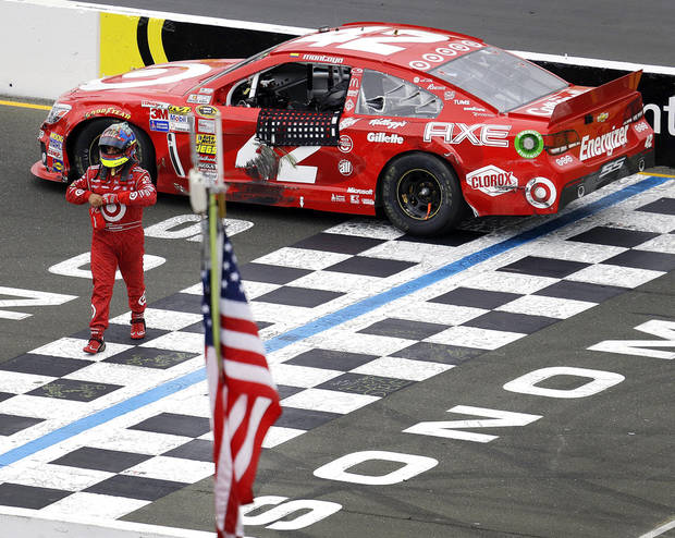 Juan Pablo Montoya, of Colombia, leaves his car after it ran out of gas on the finish line at the end of the NASCAR Sprint Cup series auto race on Sunday, June 23, 2013, in Sonoma, Calif. (AP Photo/Ben Margot)