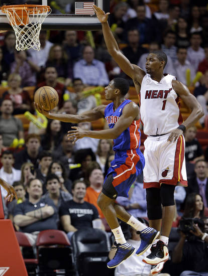 Detroit Pistons guard Brandon Knight goes up for a shot against Miami Heat center Chris Bosh (1) during the first half of an NBA basketball game, Friday, Jan. 25, 2013 in Miami. (AP Photo/Wilfredo Lee)