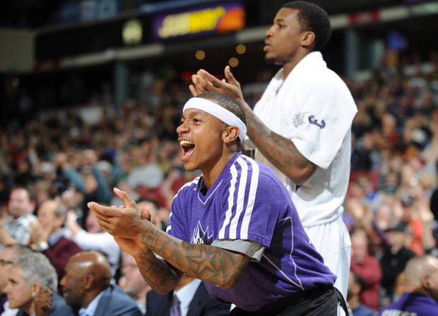 Isaiah Thomas of the Sacramento Kings against the Boston Celtics and teammate Thomas Robinson celebrate a basket by Jimmer Fredette  during an NBA basketball game on Sunday, Dec. 30, 2012 at Sleep Train Arena in Sacramento, Calif. (AP Photo/ The Sacramento Bee, Hector Amezcua)MANDATORY CREDIT
